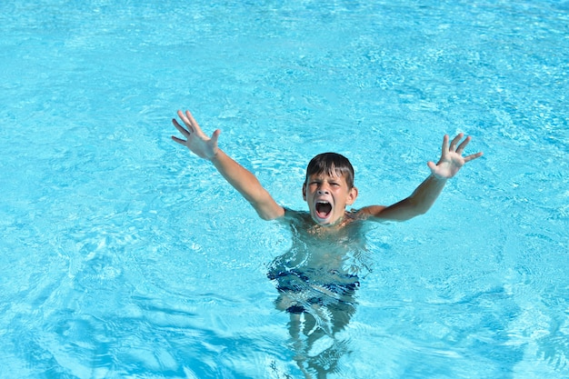 The boy drowns in the water in the pool or the sea and calls for help Premium Photo