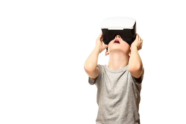 Boy experiencing virtual reality raising his head Premium Photo