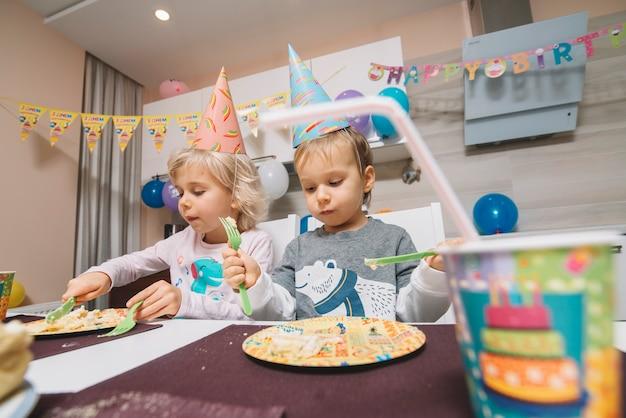 Sensational Boy And Girl Eating Birthday Cake Free Photo Funny Birthday Cards Online Hendilapandamsfinfo