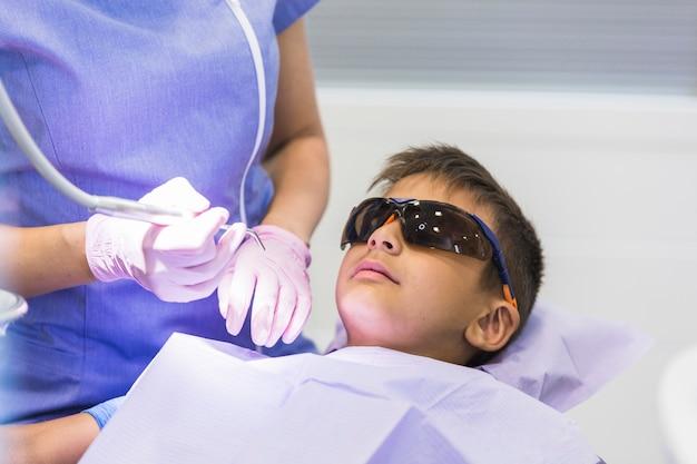 Boy having dental checkup in clinic Free Photo