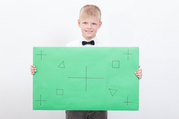 The boy holding a placard Free Photo