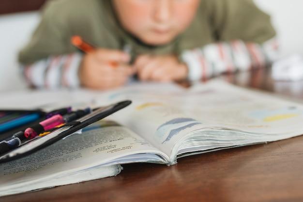 Boy is doing his homework Free Photo