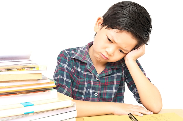 A boy is unhappy doing homework Free Photo