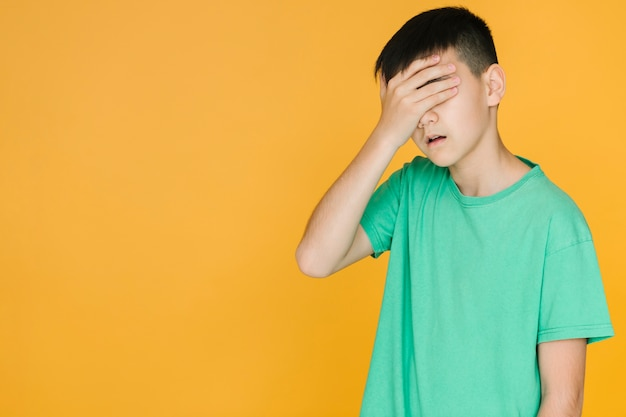 Boy looking disappointed with copy space Free Photo