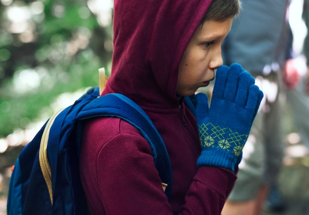 Boy lost and cold in a forest Premium Photo