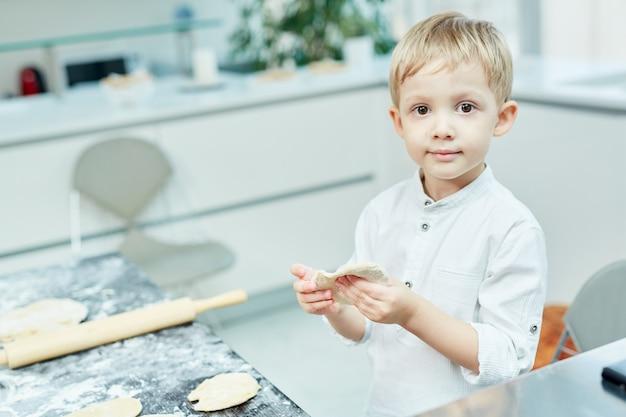 Boy making pastry Free Photo