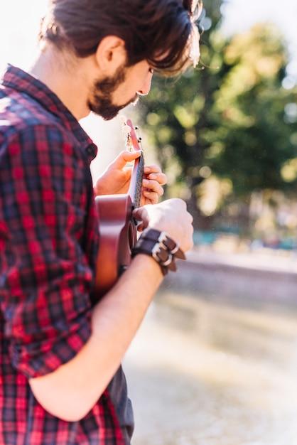 Boy playing the ukelele Free Photo
