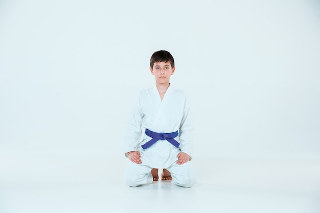 The boy posing at aikido training in martial arts school. healthy lifestyle and sports concept Free Photo