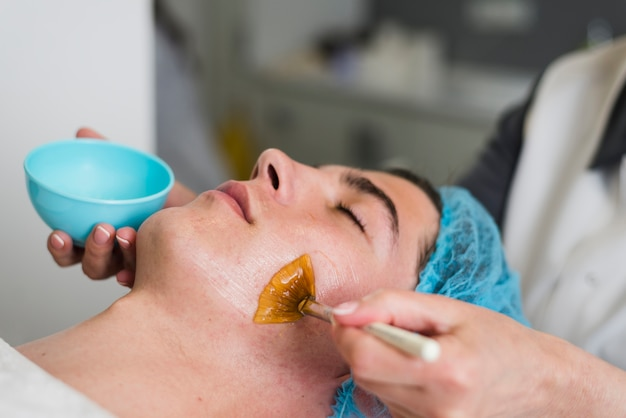 Boy receiving facial treatment in a beauty salon Free Photo
