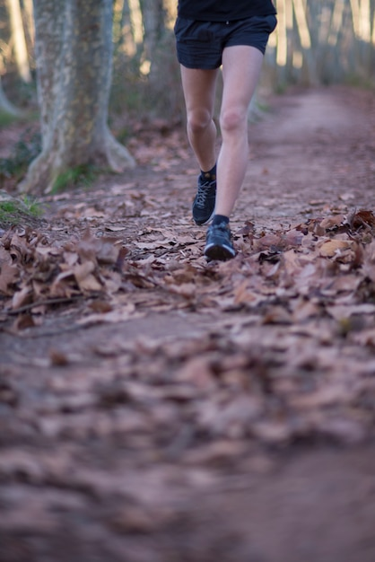 Boy running in a natural place Premium Photo