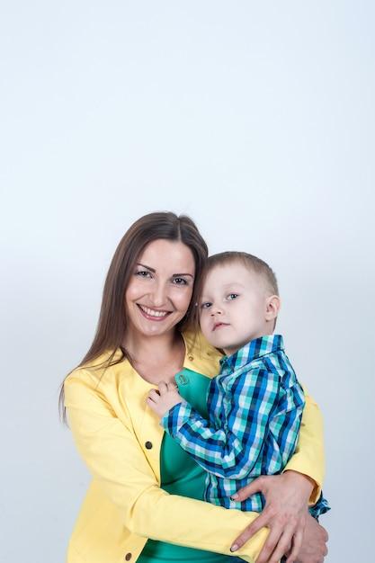 Boy in shirt sitting with mom Premium Photo