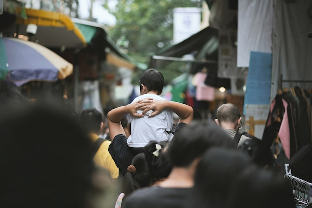 Boy sitting on his father's shoulders Premium Photo
