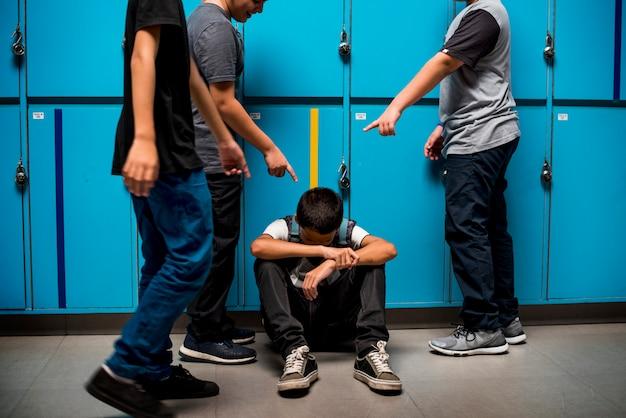 Boy student getting bullied in school Premium Photo