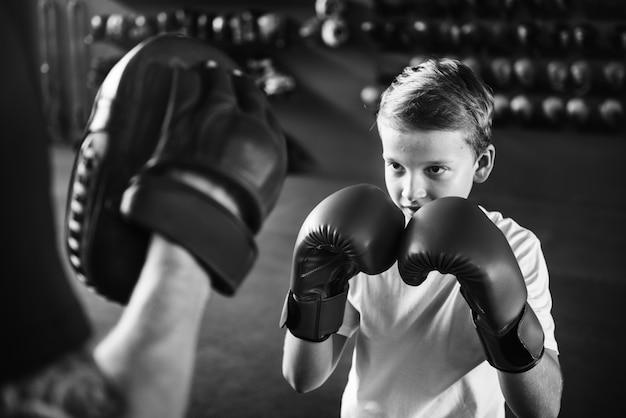 Boy training boxing exercise movement concept Premium Photo