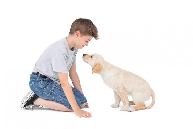 Premium Photo | Boy with dog over white background