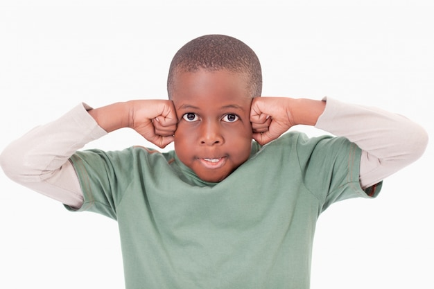 Boy with the fists on his face Premium Photo