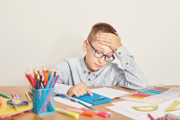 A boy with glasses is engaged in lessons Premium Photo