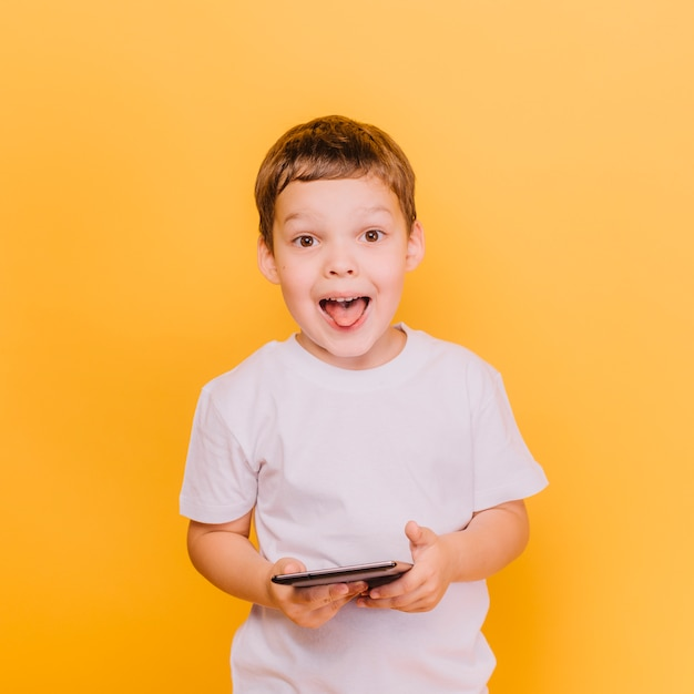 Boy with playful expression Free Photo