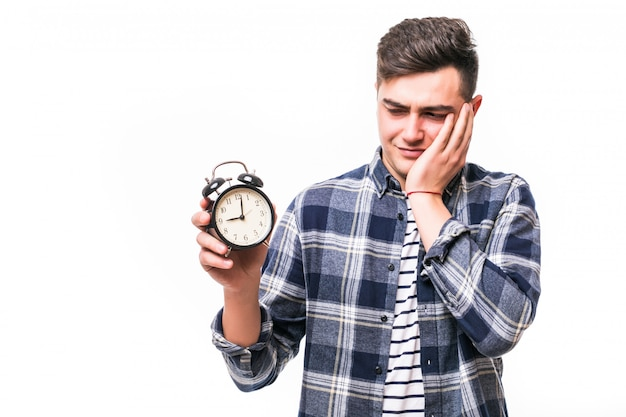 Boy with red alarm-clock understand he is late Free Photo