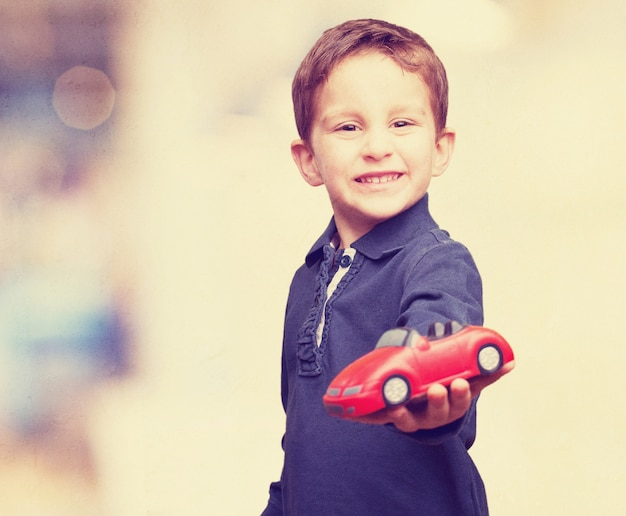 Boy with a toy car Free Photo