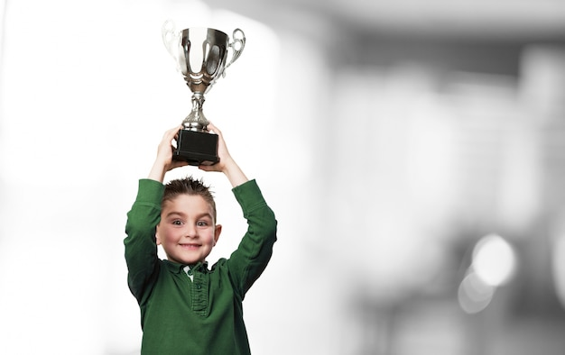 Boy with a trophy Free Photo