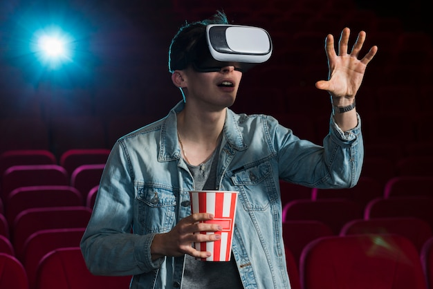 Boy with vr glasses in cinema Free Photo