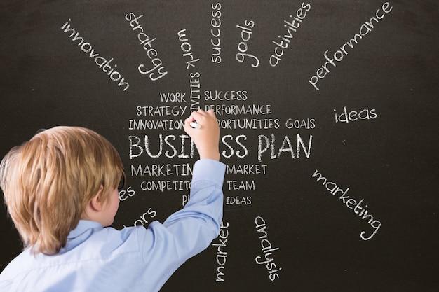 Boy writing on a blackboard Free Photo