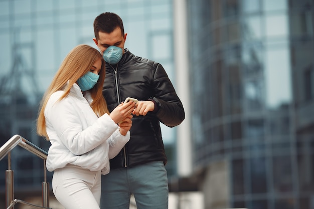 Boyfriend and girlfriend are making selfie and wearing disposable masks Free Photo