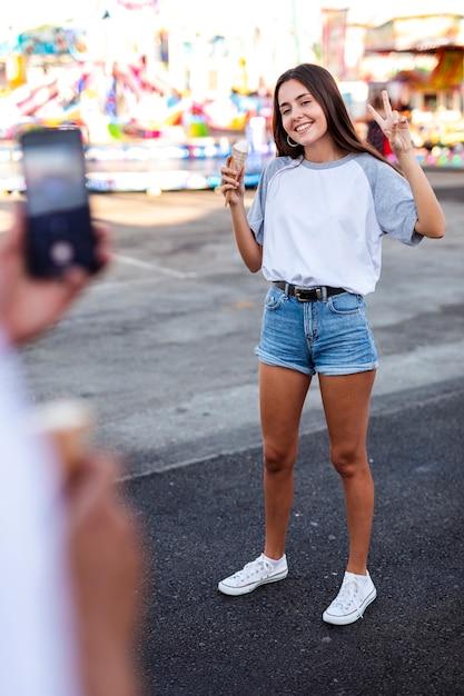 Boyfriend taking photo of girlfriend Free Photo
