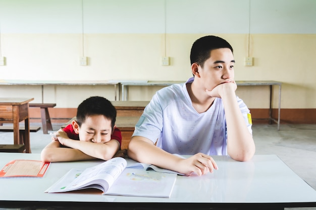 Boys are boring to study in classroom Premium Photo