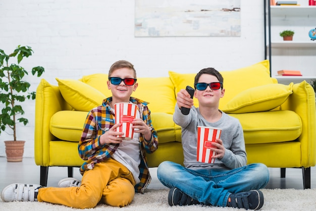 Boys on couch with 3d glasses Free Photo