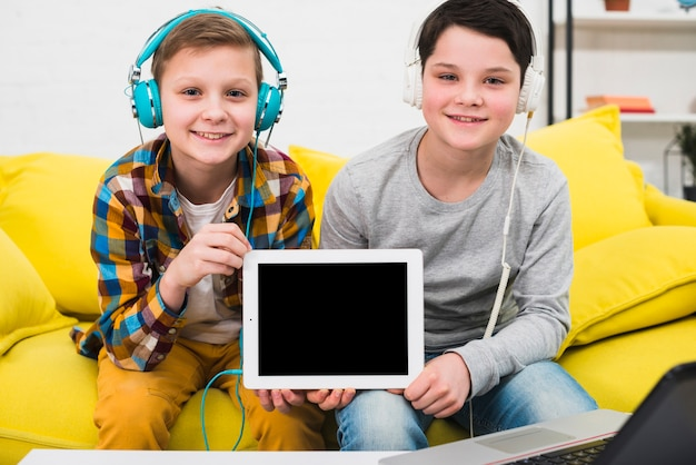 Boys presenting tablet Free Photo