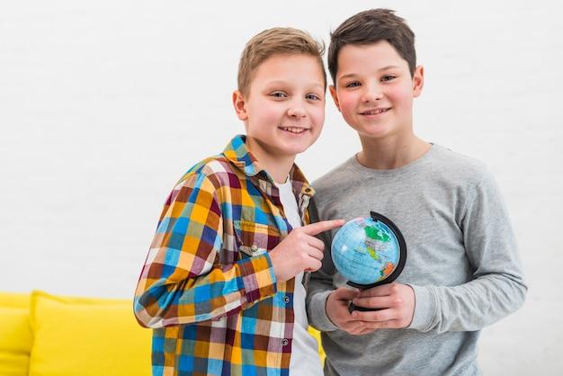 Boys with globe Free Photo