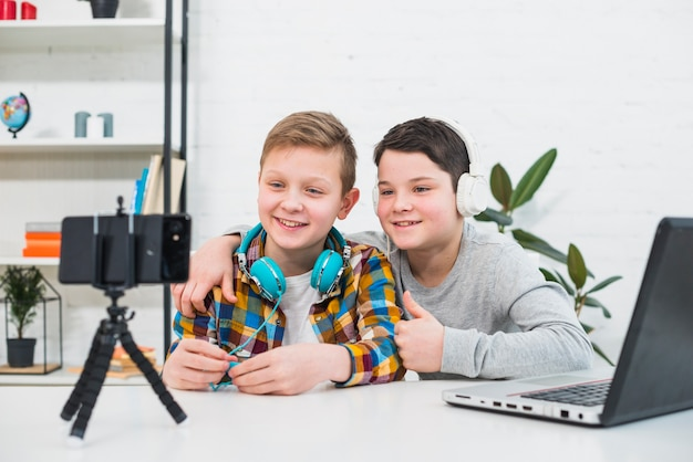Boys with laptop and smartphone Free Photo