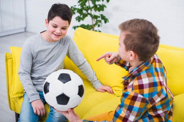 Boys with soccer ball Free Photo