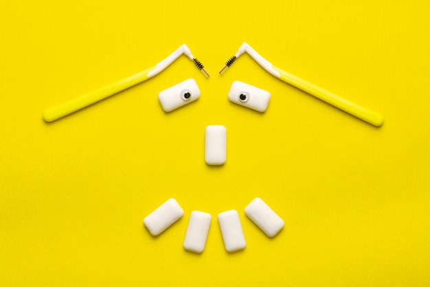 Braces cleaning concept with funny smile face shaped chewing gums pads. Premium Photo