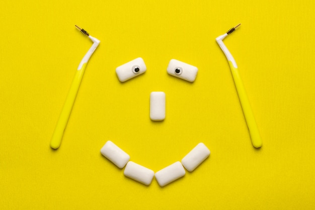 Braces cleaning concept with funny smile face shaped chewing gums pads Premium Photo