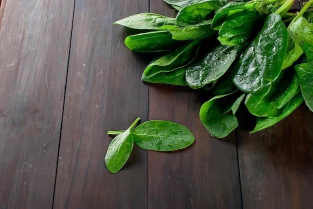 Branch spinach  on dark wooden background Premium Photo