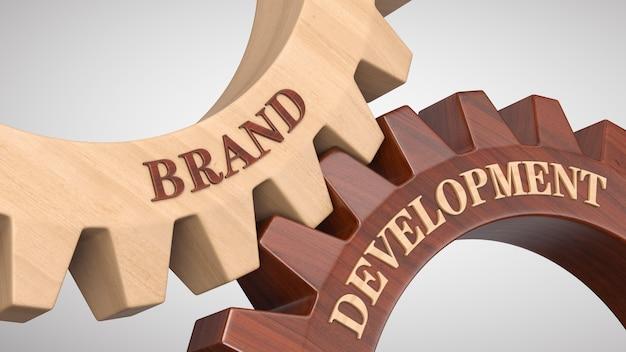 Развитие бренда написано на шестерне Premium Фотографии