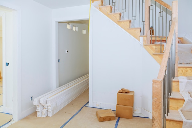 Brand new house construction interior room with unfinished wood floors. Premium Photo