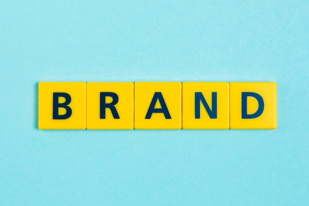 Brand word on scrabble tiles Free Photo