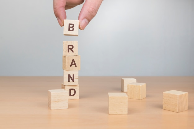 Brand word written on wood block Premium Photo