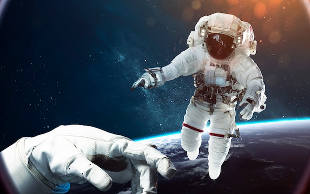 Brave astronaut at the spacewalk. people in space. Premium Photo