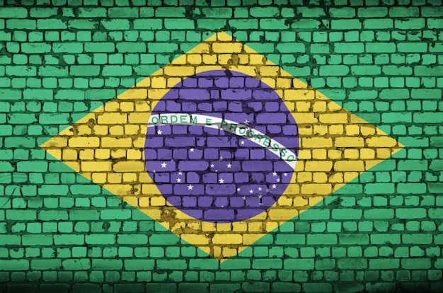 Brazil flag is painted onto an old brick wall Premium Photo