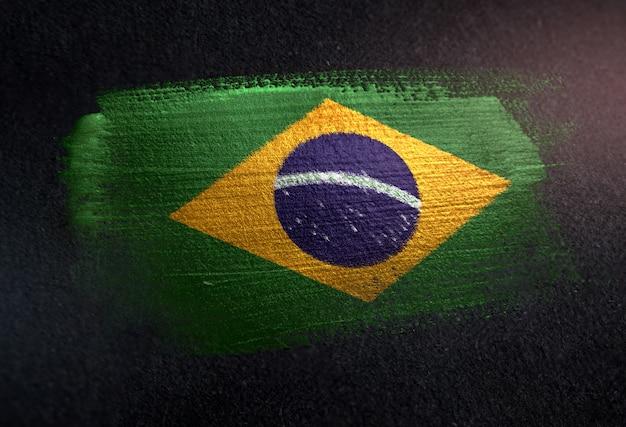 Brazil flag made of metallic brush paint on grunge dark wall Premium Photo