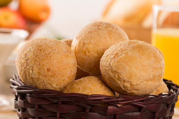 Brazilian cheese buns . table cafe in the morning with cheese bread and fruits. Premium Photo