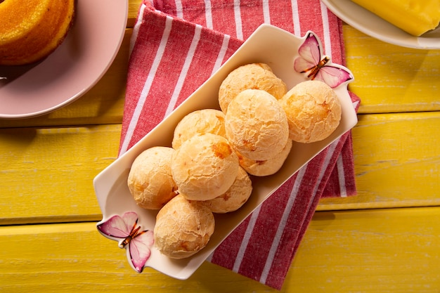 Brazilian cheese buns . table coffee in the morning with cheese bread in basket. Premium Photo