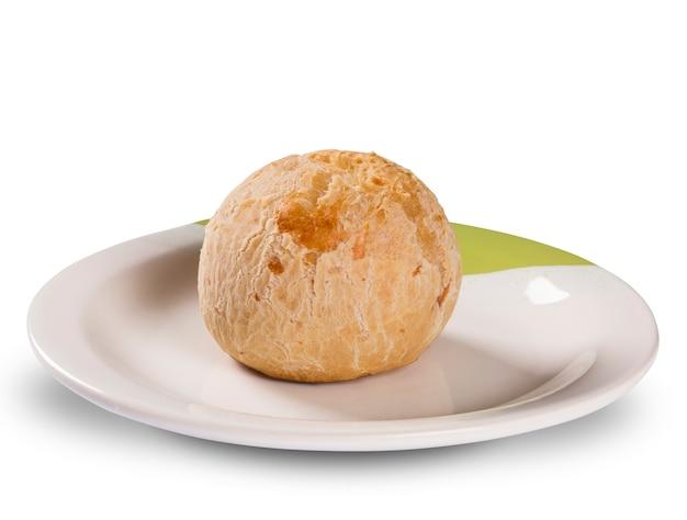 Brazilian cheese buns in white surface. pao de queijo. Premium Photo