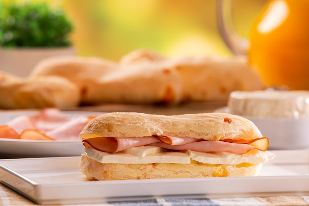 Brazilian cheese buns with cheese and ham . table coffee in the morning with cheese bread. Premium Photo