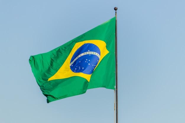 Brazilian flag flying with blue sky Premium Photo